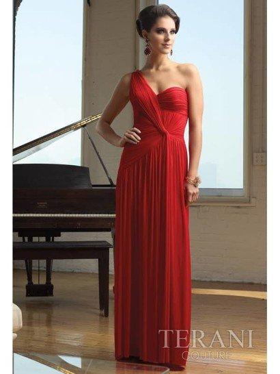 Это длинное вечернее платье с бретелью через одно плечо восхищает дизайном сложной драпировки асимметричного удлинённого торса в духе творений Мадлен Вионне.  Открытая спина декорирована эффектным «захватом».  Вертикали густых складок ниспадают к подолу стройной колонной.