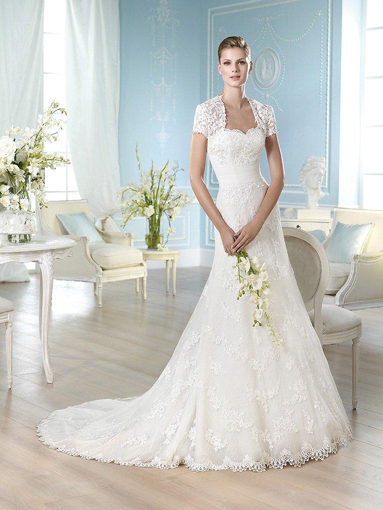 Кружевное свадебное платье с облегающим силуэтом «русалка».