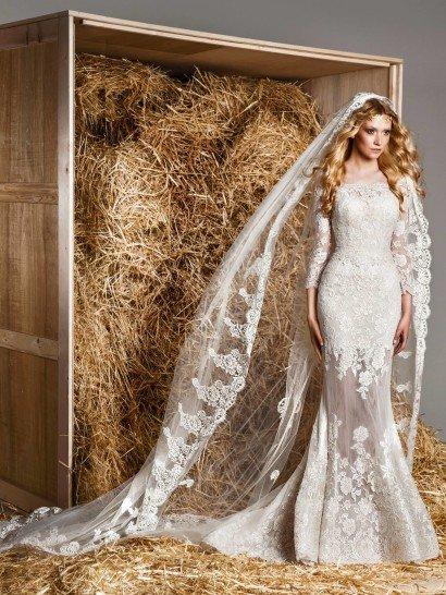 Кружевное свадебное платье-трансформер с пышной верхней юбкой и полупрозрачной нижней.