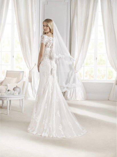Открытое свадебное платье силуэта русалка.