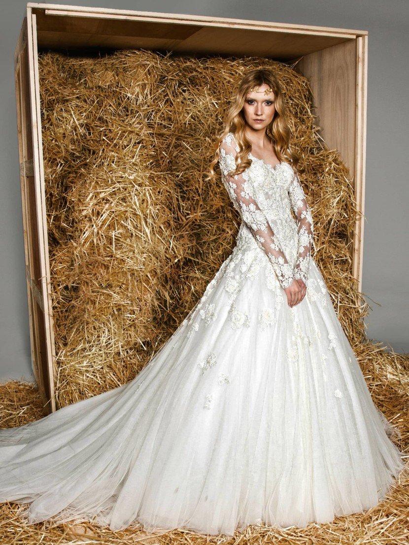 Стильное свадебное платье пышного кроя с роскошными длинными рукавами из кружева.
