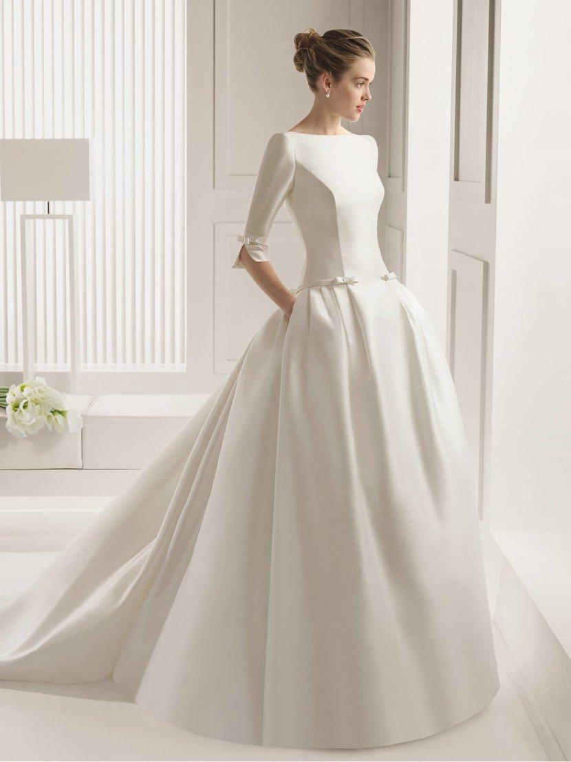 Свадебное платье с рукавами и карманами.
