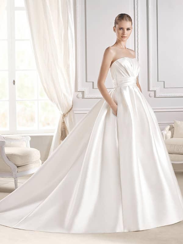 Стильное свадебное платье с карманами.