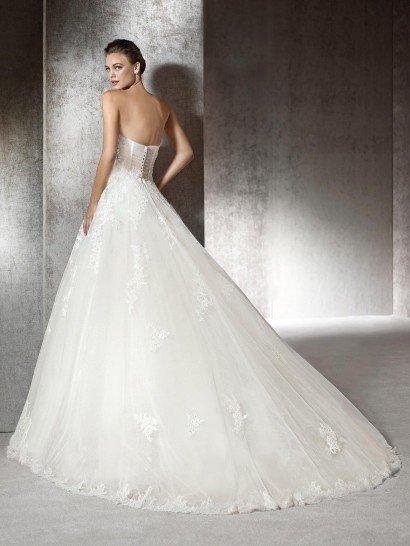 Шикарное открытое свадебное платье.