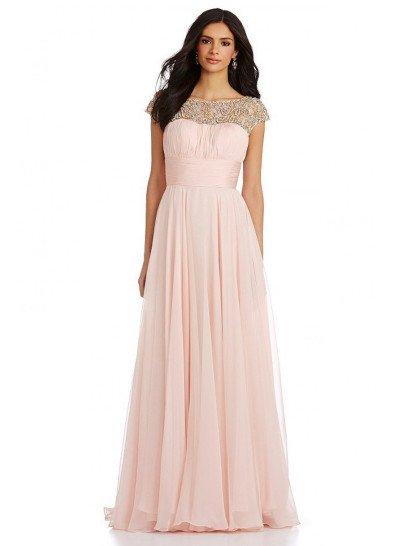 Нежное вечернее платье светлого розового цвета женственно подчеркивает фигуру, главный акцент делая на талию, которая охвачена широким поясом. Открытый лиф с соблазнительным декольте дополняет тонкая вставка, полностью покрытая сверкающей вышивкой из крупных серебристых бусин. На спинке располагается такой же декор. Элегантная юбка прямого кроя выполнена из нескольких слоев шифона, сзади складывающихся шлейфом.