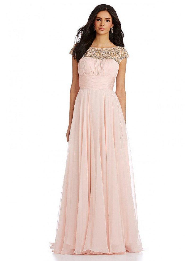 Нежное вечернее платье светлого розового цвета.