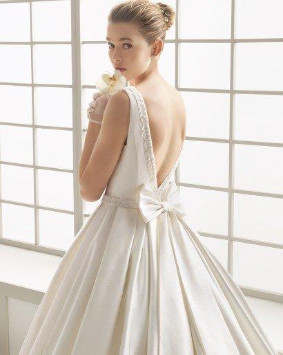 Закрытое свадебное платье с карманами - изысканный пышный силуэт.