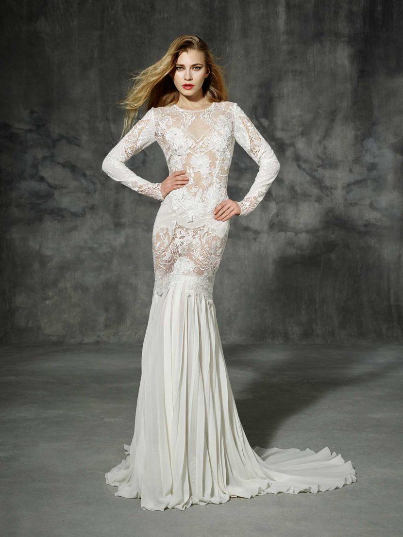 Облегающее свадебное платье силуэта «русалка» с длинным рукавом.