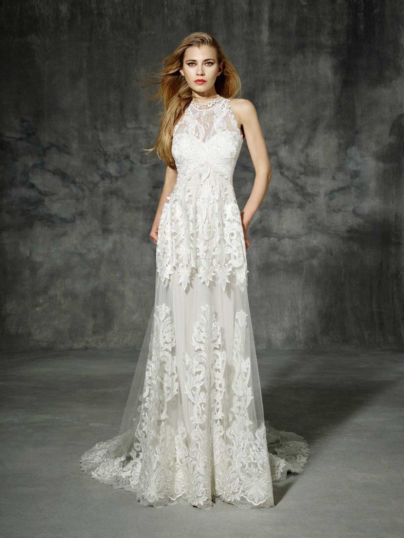 Стильное свадебное платье с необычным ажурным декором по всей длине.