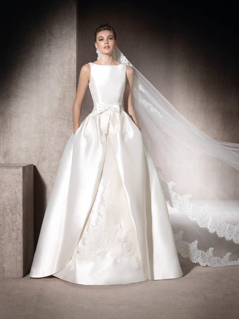 Свадебное платье-трансформер с пышной верхней юбкой.