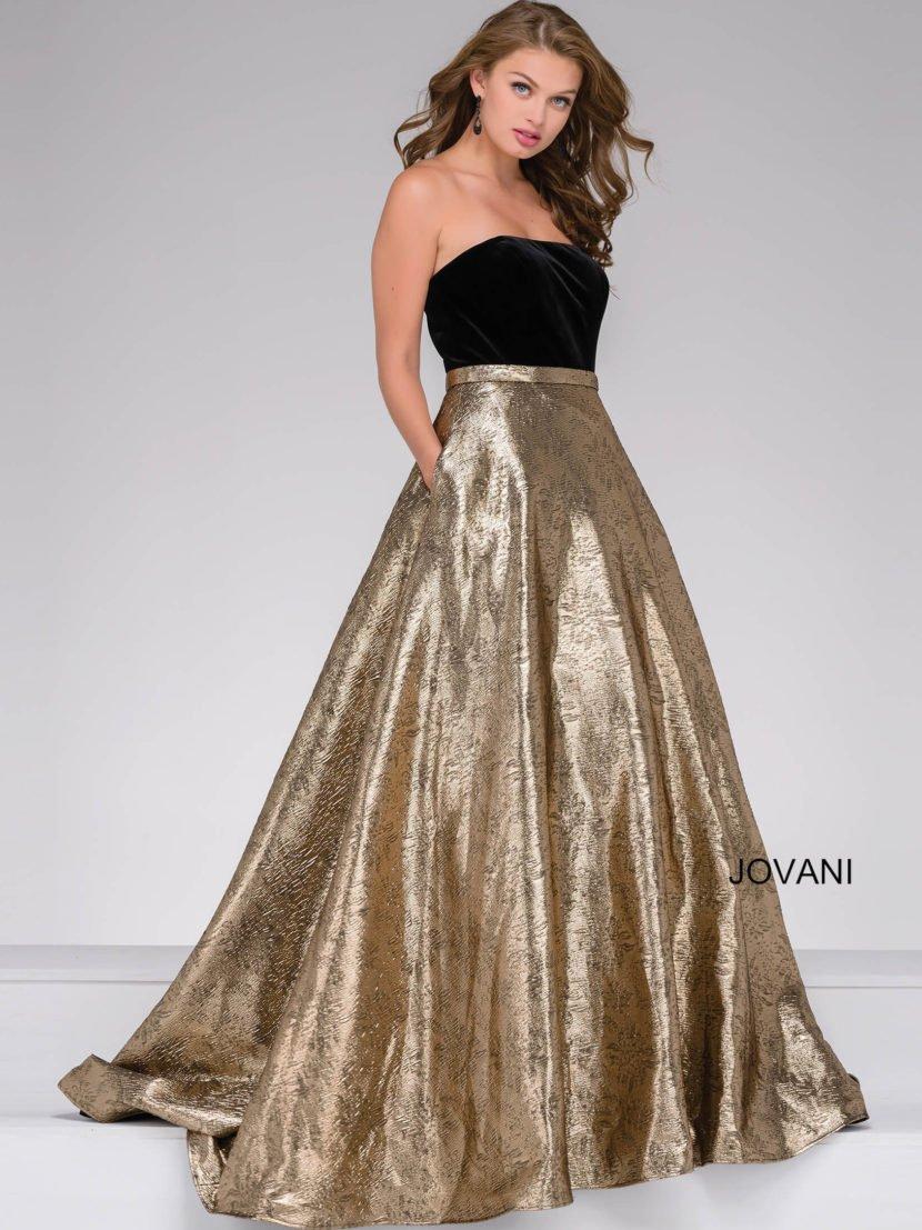 Вечернее платье с черным бархатным лифом и золотистой юбкой «принцесса» с карманами.