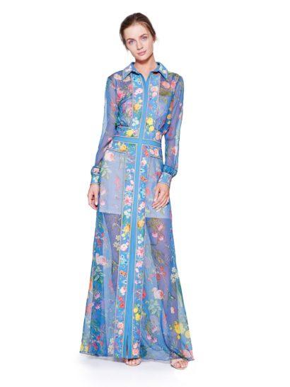 Это вечернее платье очарует вас своим французским духом – рисунок на ткани вдохновлен картинами Боннара, выполненными в стиле импрессионизм. Оригинальный крой платья-рубашки деликатно подчеркивает фигуру.  Под тонким голубым шифоном располагается белая подкладка с мини-юбкой, придающая образу соблазнительность. Уравновешивают ее длинные рукава и изящный воротник.