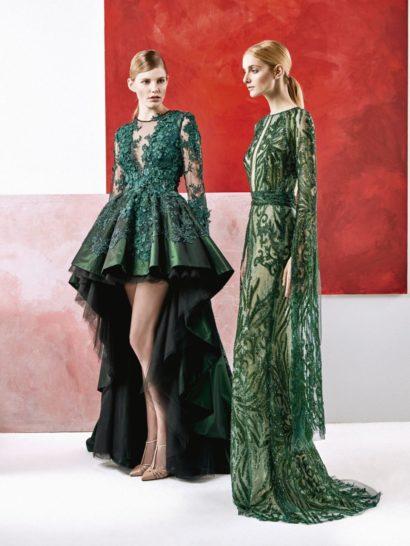 Изысканность и элегантность сочетаются в этом вечернем платье от кутюр, оформленном стразами и дополненном пышным шлейфом из изумрудно-зеленой тафты. Уникальное платье с длинным рукавом красиво облегает линию талии. Объемные цветочные аппликации покрывают платье по всей длине: на рукавах, на талии, у декольте.  Объемная юбка, удлиненная сзади, делает образ торжественнее и позволяет использовать его для самых торжественных мероприятий.