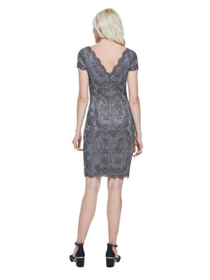 Коктейльное платье с коротким рукавом и изысканной вышивкой по тонкой ткани.