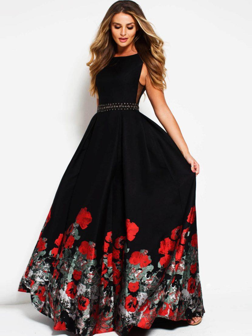 Черное вечернее платье с юбкой в пол и открытой спинкой.