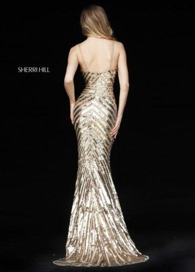 Золотистое вечернее платье «русалка» с лифом на тонких бретелях.
