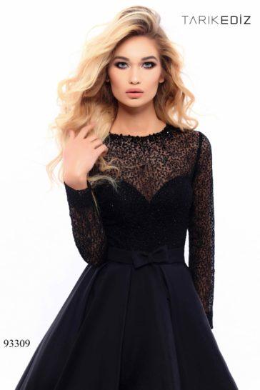 Черное вечернее платье с пышной юбкой, укороченной спереди.