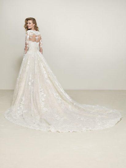 Пышное свадебное платье со съемным верхом с длинным рукавом.