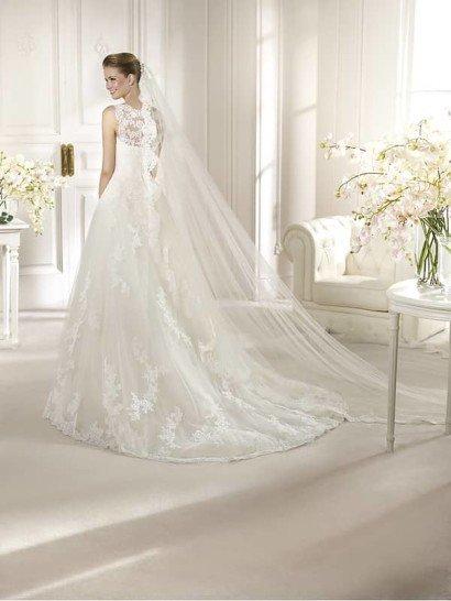 Свадебное платье с кружевным верхом.