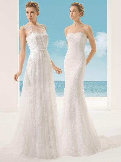 Открытое свадебное платье прямого силуэта можно преобразить нежным полупрозрачным верхом из тонкой ткани с декором из крупных кружевных аппликаций по краям и по подолу.  Вертикальные складки ткани по юбке делают дополнительный верх романтичнее и торжественнее.  Без него платье акцентирует декольте лифом в форме сердца с ажурным краем.  В качестве аксессуара в образе служит узкий пояс с бантом.