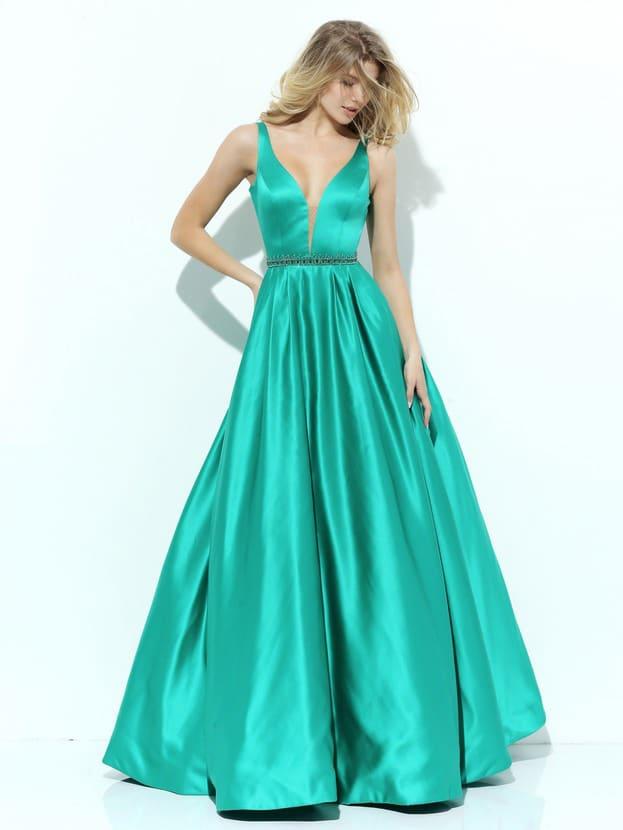 Бирюзовое вечернее платье с глубоким декольте и эффектной юбкой А-силуэта.