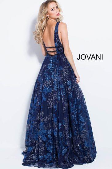Темно-синее вечернее платье с глянцевым рисунком и узкими поясами на талии.