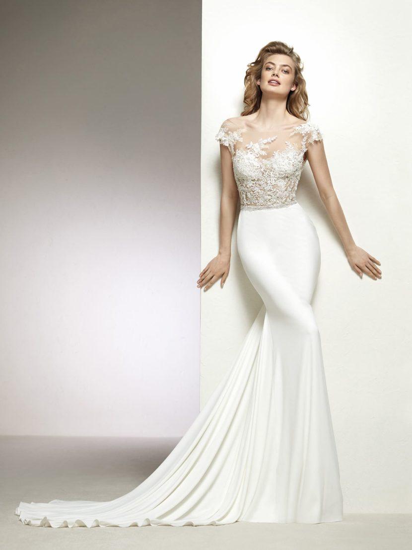 Свадебное платье «русалка» с полупрозрачным верхом и открытой спинкой.