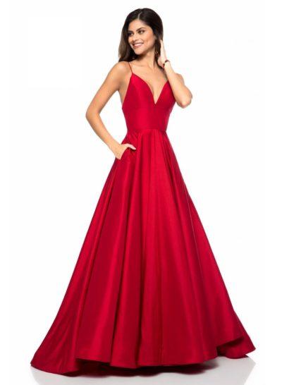 Великолепное вечернее платье создано из ярко-красной тафты.  Деликатный блеск плотной ткани прекрасно дополняет А-силуэт роскошной юбки с небольшим подолом сзади.  Область декольте очерчена открытым лифом в форме «сердечка» на бретельках-спагетти. Спинка открыта еще более выразительным декольте.